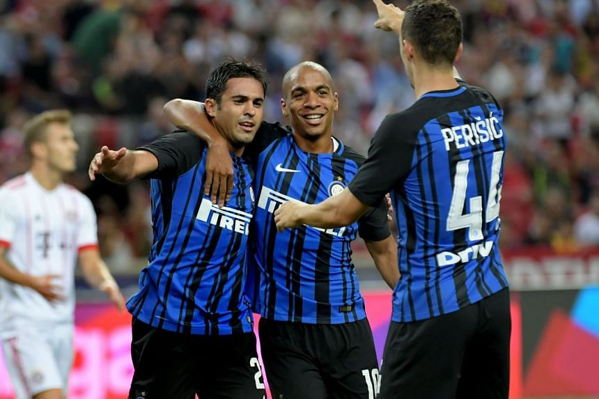 Inter Milan striker Eder Martins (left) celebrating with teammates Joao Mario (centre) and Ivan Perisic, after scoring the opening goal during their ICC match against Bayern Munich at the National Stadium, on July 27, 2017.