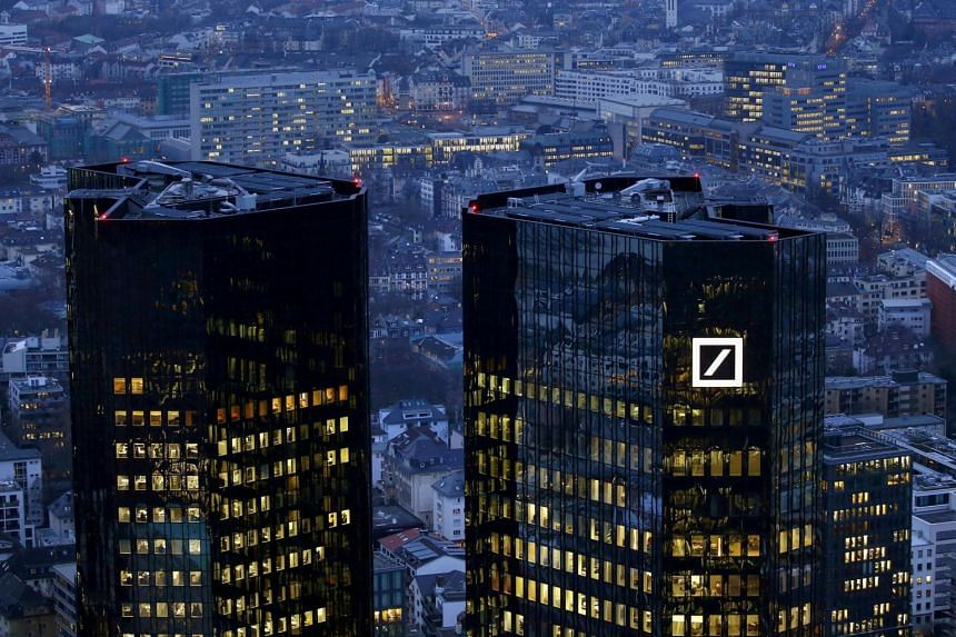 The headquarters of Germany's Deutsche Bank in Frankfurt. Earnings at the investment bank declined 16 per cent from a year ago, driven by a 18 per cent slump in trading revenue and a 12 per cent drop in global transaction banking.