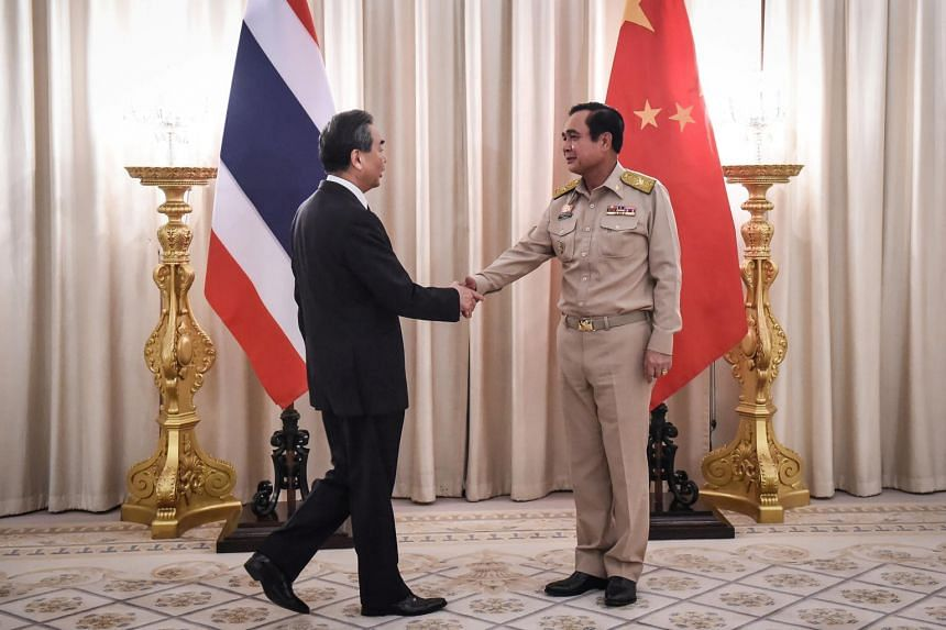 Chinese Foreign Minister Wang Yi (left) and Thai Prime Minister Prayut Chan-O-Cha at Government House in Bangkok, Thailand, on July 24, 2017.