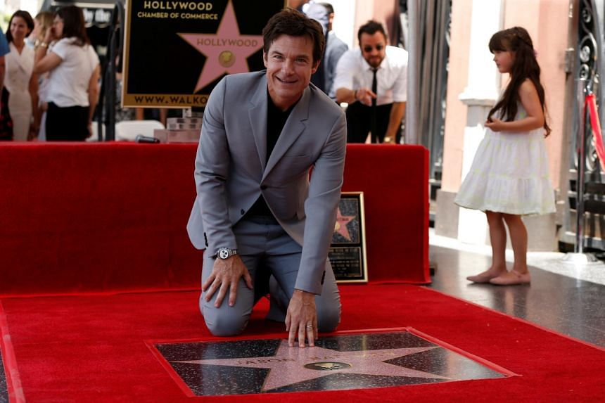 Actor Jason Bateman touches his star after it was unveiled on the Hollywood Walk of Fame in Los Angeles, California.