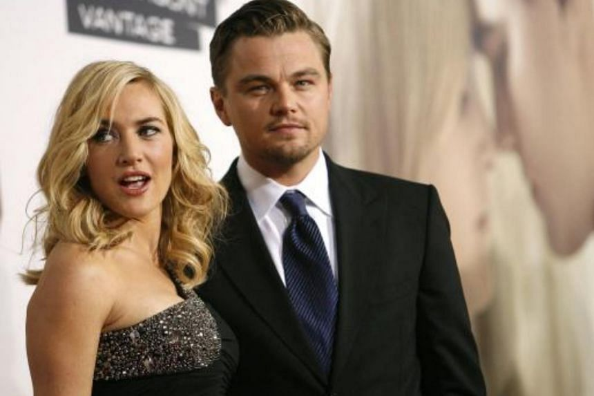 Kate Winslet poses with co-star Leonardo DiCaprio at the premiere of the movie Revolutionary Road.