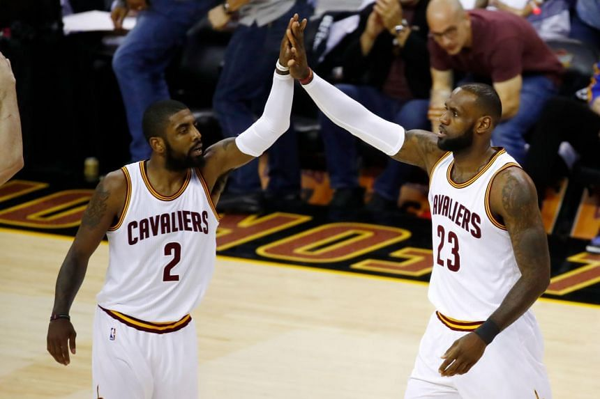 Kyrie Irving #2 and LeBron James #23 of the Cleveland Cavaliers high five against the Golden State Warriors in Game 4 of the 2017 NBA Finals.