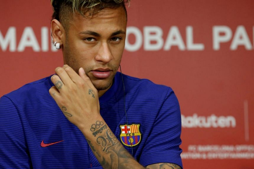 Neymar attending a news conference in Tokyo.
