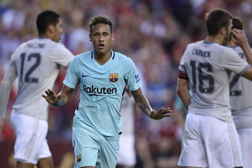 Barcelona's Neymar gestures after scoring during their International Champions Cup (ICC) football match against Manchester United.