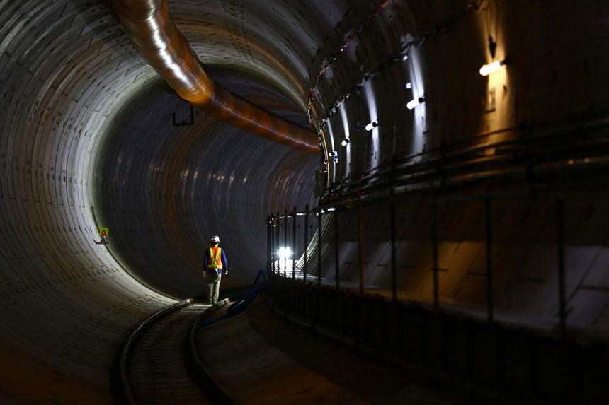 A worker walking along a tunnel inside the Mass Rapid Transportation (MRT) project in Jakarta.