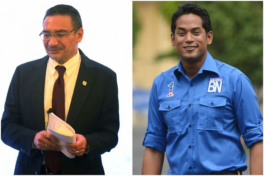 Defence Minister Datuk Seri Hishammuddin Hussein and Mr Khairy Jamaluddin, the youngest minister in Mr Najib's cabinet.