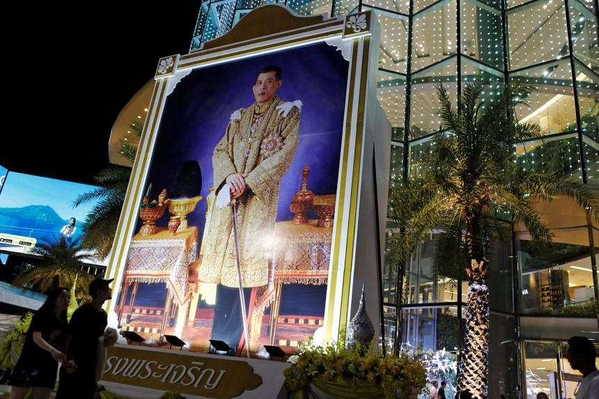 A portrait of Thai King Maha Vajiralongkorn is seen at a shopping mall on the eve of his 65th birthday in Bangkok.