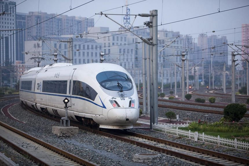A Tianjin bound China Railways CRH3 high speed train departs the Beijing South station in Beijing, China.