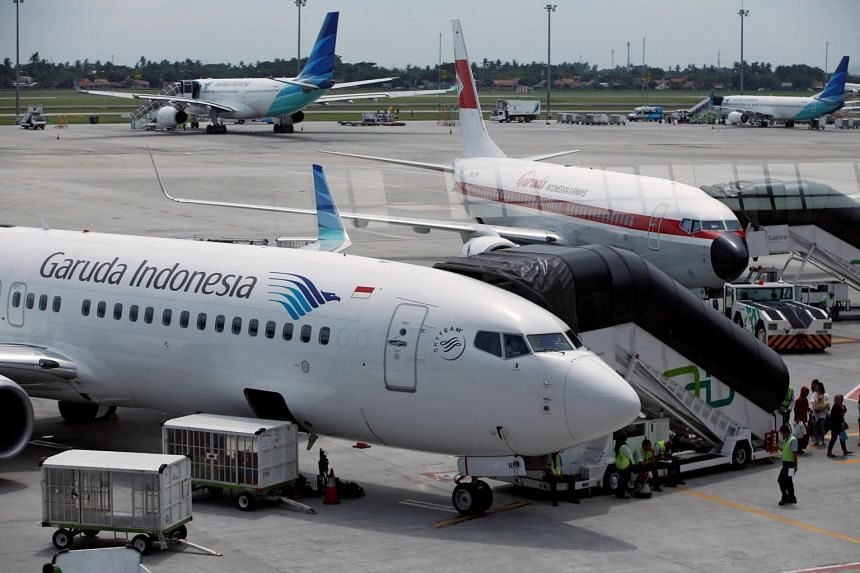 Indonesia's air traffic controllers have warned of the risk of aircraft collisions and accidents unless their workload is eased.