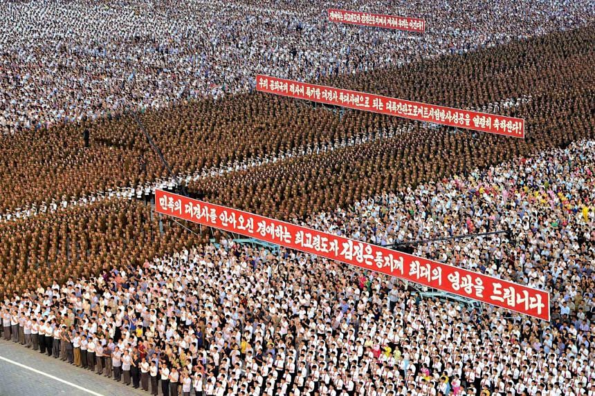 Army personnel and people gather for a celebration at Kim Il Sung Square in Pyongyang on July 6, 2017.