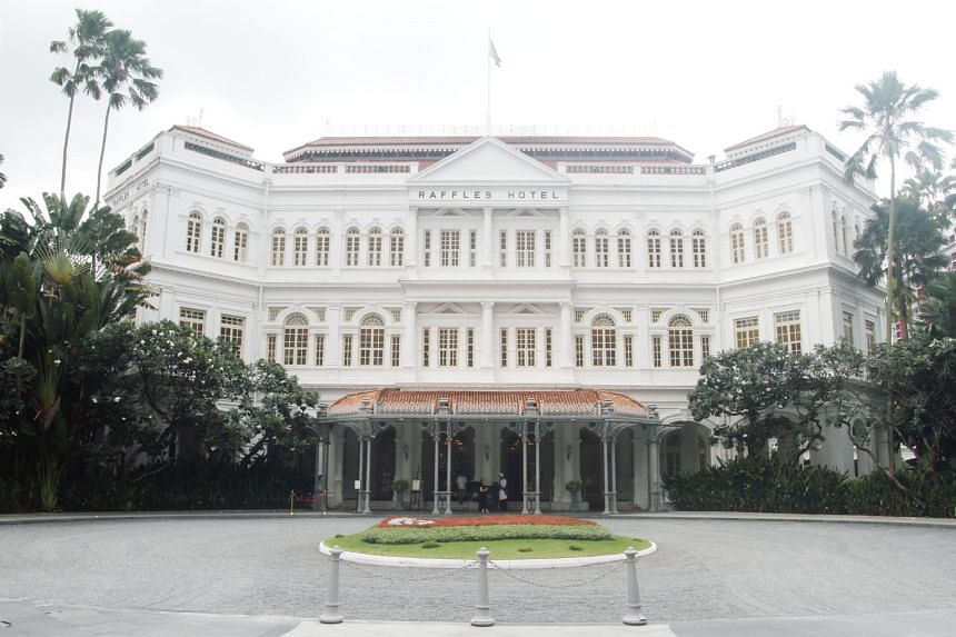 Above: The exterior of the Raffles Hotel is kept pristine white all year round.