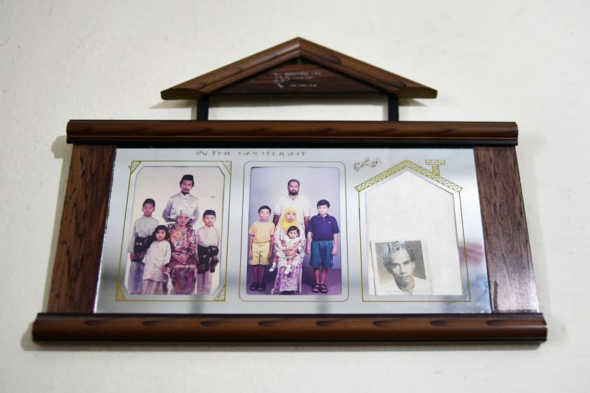 Left: Madam Zulaika Mohamad Osman holding a photo of her 1961 wedding with Mr Ismail Awang (enlarged version on top) outside her Circuit Road home. Above: Some of Madam Zulaika's family photos, including two of her children and their families, and a