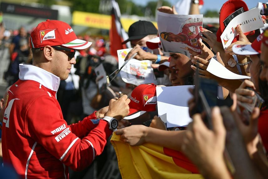 Vettel signs autographs at the Hungaroring racetrack, July 27, 2017.