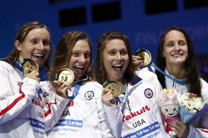 (From left) Leah Smith, Mallory Comerford, Melanie Margalis and Katie Ledecky of the US pose with their medals.