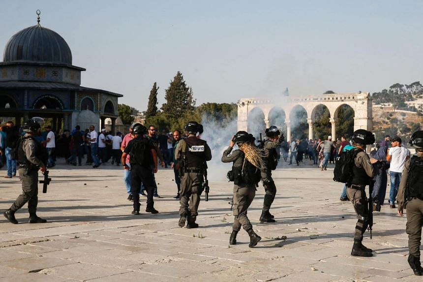 Tear-gas fumes are seen in the Haram al-Sharif compound, as Israeli security forces disperse Palestinians who entered the complex, in the old city of Jerusalem on July 27, 2017.