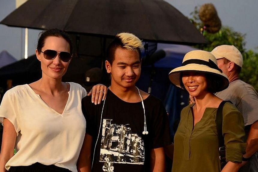 Actress Angelina Jolie with her son Maddox and writer Loung Ung, whose memoir First They Killed My Father has been turned into a film, directed by Jolie.