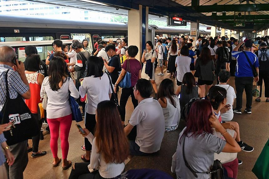 Commuters waiting at the platform after train service at Khatib station was affected by a signalling problem on June 28. Mr Khaw Boon Wan asked for the public's understanding during the new signalling system's testing phase, which he said would take