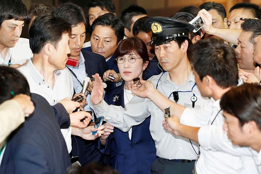 Ms Tomomi Inada leaving the Defence Ministry in Tokyo yesterday. An internal memo leaked to Fuji Television on Tuesday suggested that she was deeply involved in the decision to cover up the Japanese ground troops' mission logs in South Sudan, which e