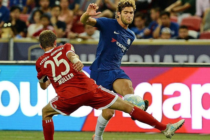 Blues left-back Marcos Alonso on the attack as Bayern Munich's Thomas Muller attempts to block his cross on Tuesday. The Spaniard had six goals and three assists in Chelsea's title-winning Premier League campaign last term.