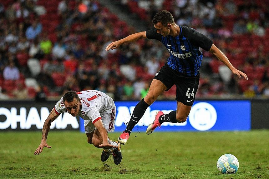 Inter Milan winger Ivan Perisic (right) and Bayern Munich right-back Rafinha in a tussle for the ball during the ICC friendly at the National Stadium yesterday. Chelsea will play Inter tomorrow evening in the final match.