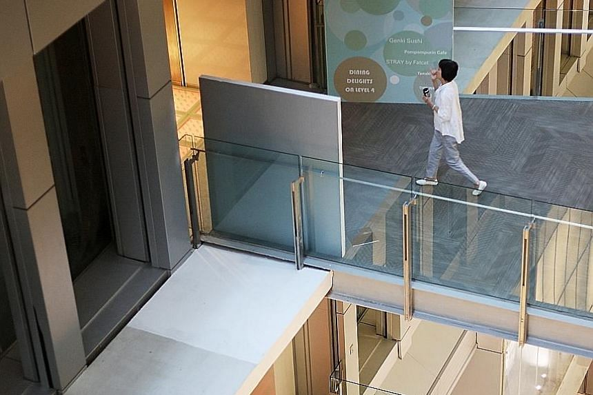 Left: Jonathan vaulted over a barrier at the fourth-storey link bridge between Orchard Central and Orchard Gateway on Feb 24 and landed on the ledge, but the platform he was on gave way and he fell to his death. Above: The platform, which Coroner Mar