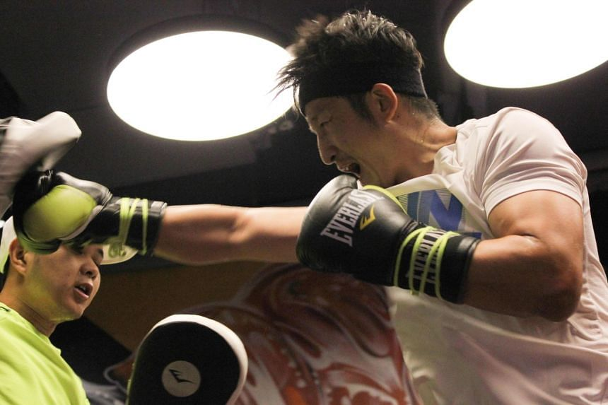 Zou (above, in a file photo) was making his first defence of the WBO crown he won last year.