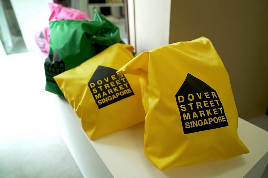 Tote bags at Dover Street Market in Singapore.