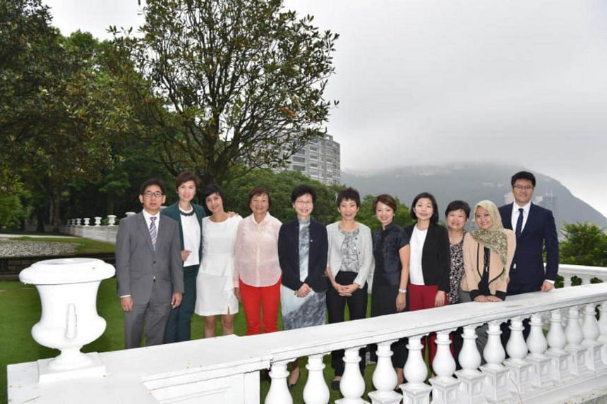 Hong Kong Chief Executive Carrie Lam with Singapore government officials at Victoria House, the official residence for the Chief Secretary, last May (2016).