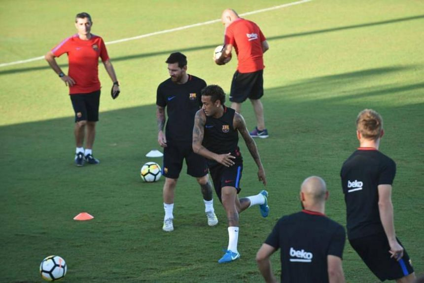 Barcelona players Lionel Messi and Neymar take part in a training session at Barry University in Miami, Florida.