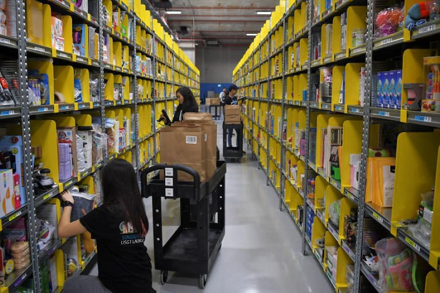 Amazon's staff preparing orders at their Prime Now facility.