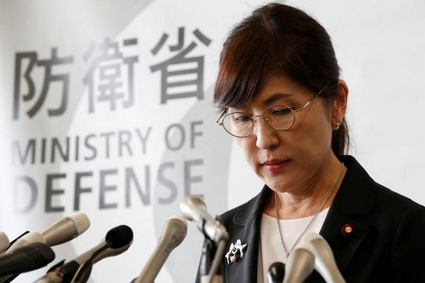 Japan's Defence Minister Tomomi Inada announces her resignation during a news conference at the Defence Ministry in Tokyo.
