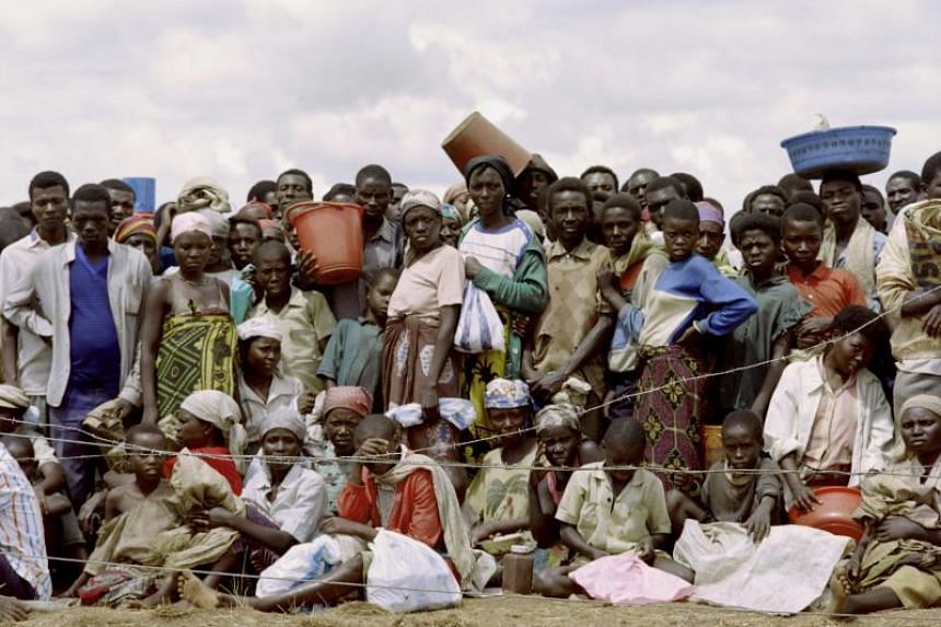 A May 1994 file photograph of Rwandan refugees as they wait for food at the refugee camp of Benako, after fleeing the massacres that has claimed an estimated 500,000 people earlier when the Rwandan army and RPF rebels went to war