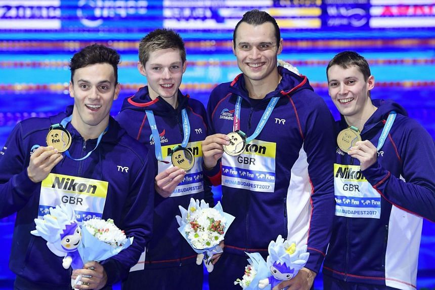 James Guy, Duncan Scott, Nicholas Grainger and Stephen Milne of Team Great Britain pose with their gold medals.