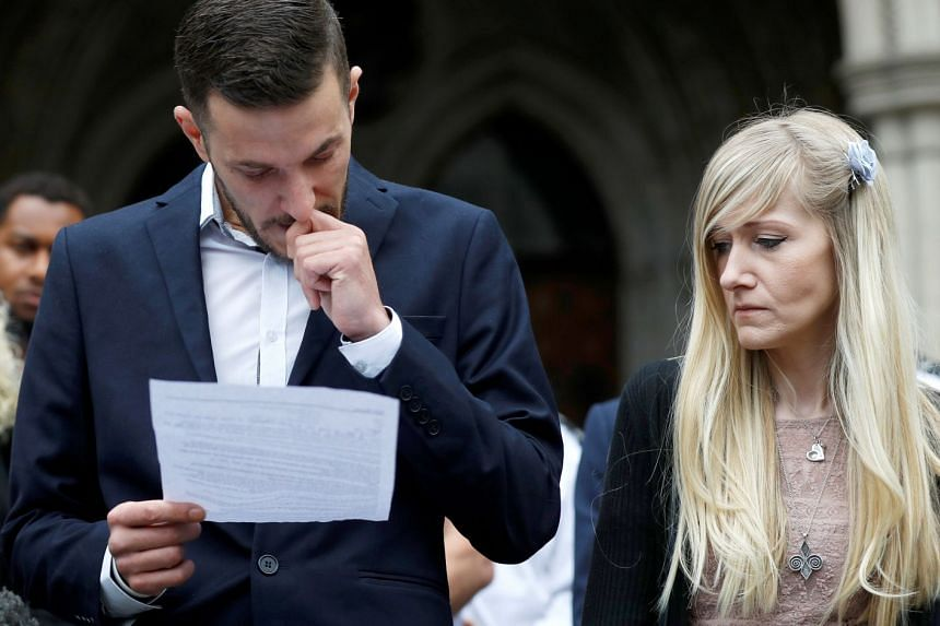 Charlie's parents Connie Yates and Chris Gard read a statement at the High Court after a hearing on their baby's future, July 24, 2017.