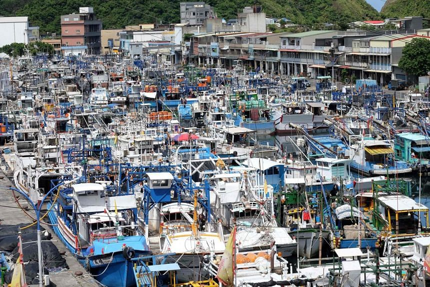 Fishing boats taking shelter at the Nanfangao fishing harbour in Suao, Yilan county in east Taiwan, as Typhoon Nesat approaches. The storm is likely to make landfall in Hualien or Taitung in eastern Taiwan later today, bringing with it strong winds a