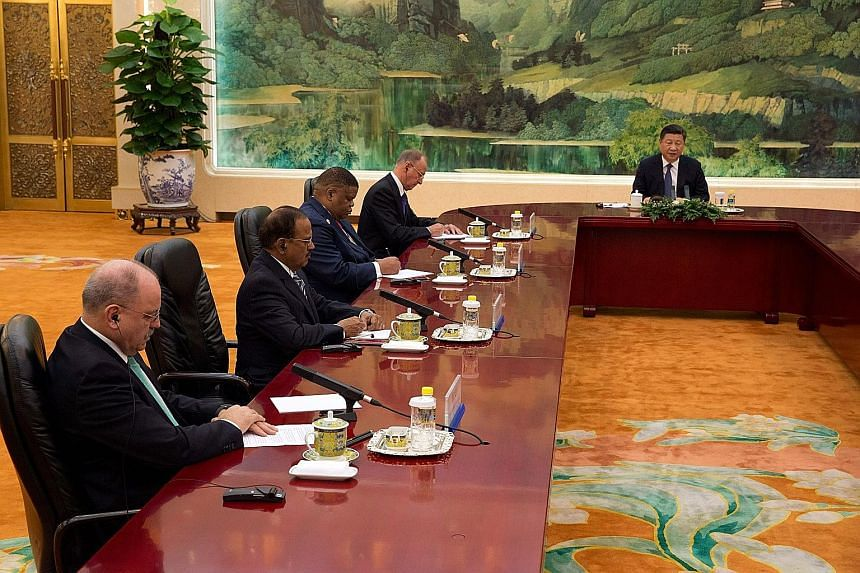 (From far left) Brazil's Institutional Security Minister Sergio Etchegoyen, India's National Security Adviser Ajit Doval, South Africa's Minister of State Security David Mahlobo and Russia's Security Council Secretary Nikolai Patrushev meeting China'