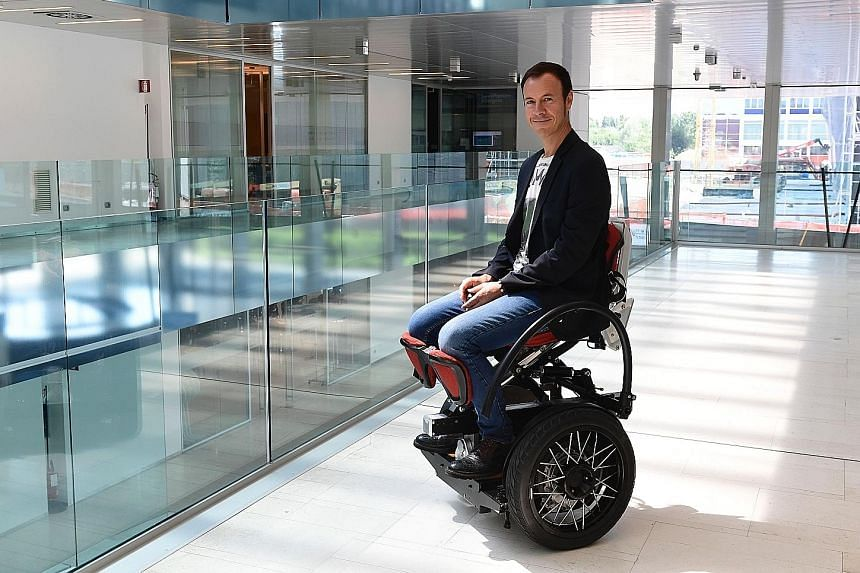 """Mr Mario Vigentini with his invention, the """"MarioWay"""". After nearly 20 years working with youngsters in wheelchairs, he wanted to revolutionise their quality of life, inventing a device that raises users so that they are face-to-face with those stand"""