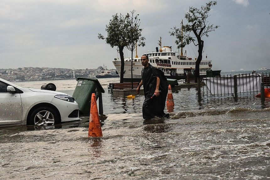 The sudden storm in Istanbul, which lasted only 20 minutes, paralysed traffic and caused flash floods that submerged cars in some streets.
