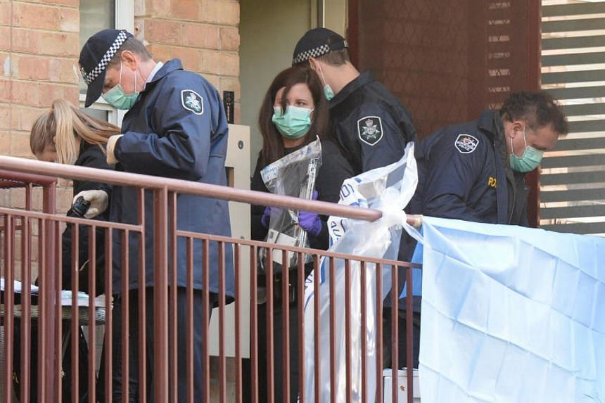 """Australian police carry out """"counter-terrorism"""" raids at an apartment block in Melbourne on June 9, 2017 that are said to be linked to the deadly siege by a lone gunman in the country's second biggest city earlier in the week."""