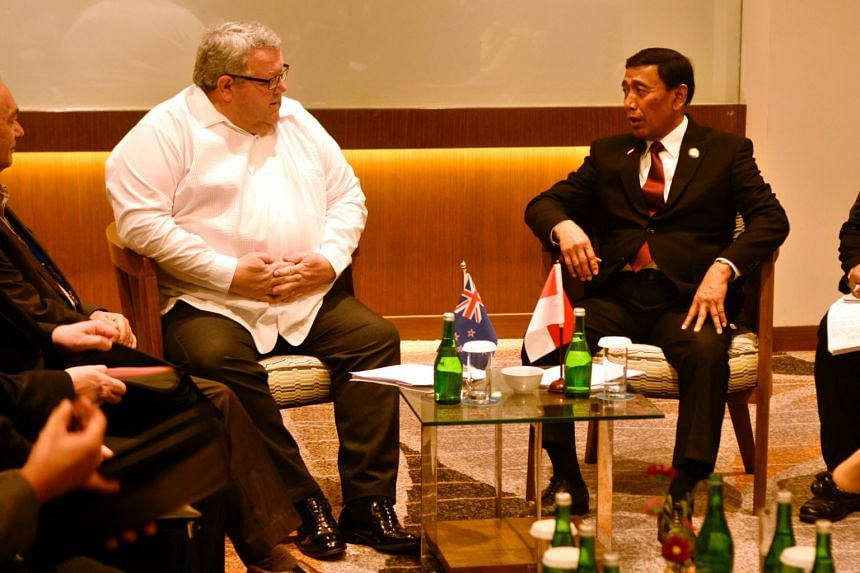 Indonesian's Coordinating Minister for Political, Legal and Security Affairs Wiranto (right) meets New Zealand's Foreign Minister Gerry Brownlee.