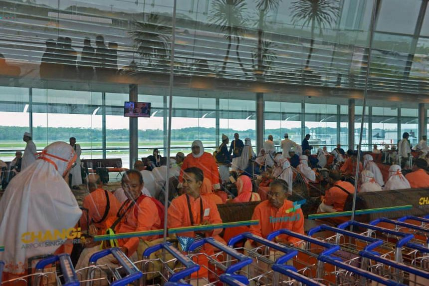 Muslims gather at Changi Airport Terminal 3's departure hall before they leave on their pilgrimage.