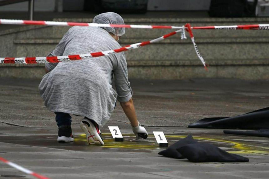 A police investigator works at the crime scene after a knife attack in a supermarket in Hamburg, Germany on July 28, 2017.