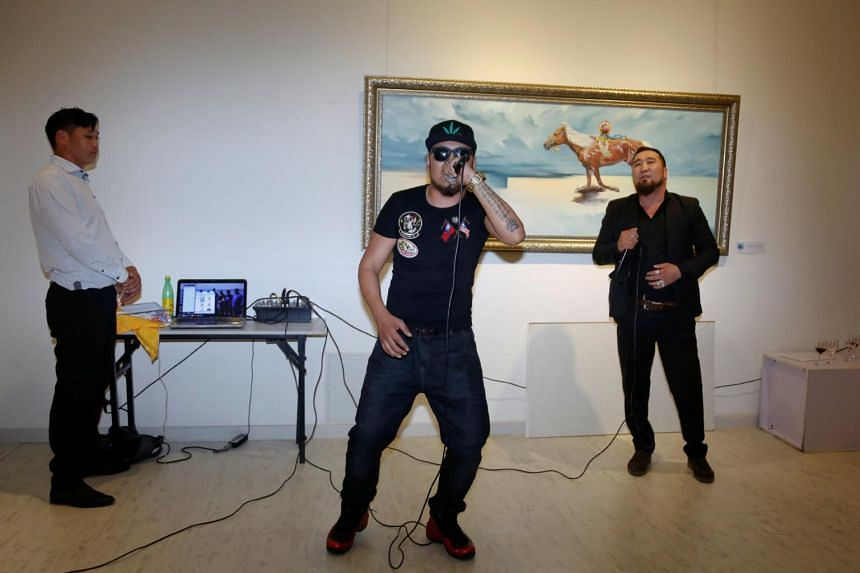 Hip pop singers Battogtokh Odsaikhan and Sanjjav Baatar of the band Fish Symboled Stamp perform in an art gallery in Ulaanbaatar, Mongolia, on June 23, 2017.