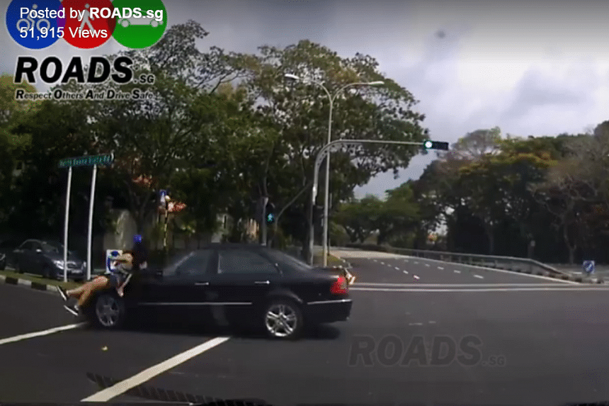 The woman appeared stunned and was helped by the driver whose dash cam captured what happened.