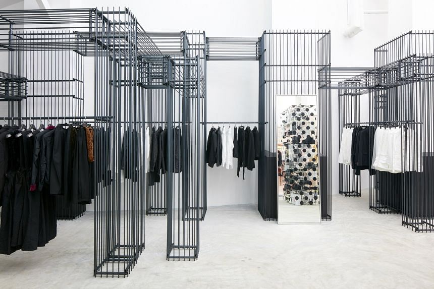 Arching across the middle of Dover Street Market is a house-like structure which holds a cashiers' station. Black Comme des Garcons (above) is one of the more than 25 brands available at the store.
