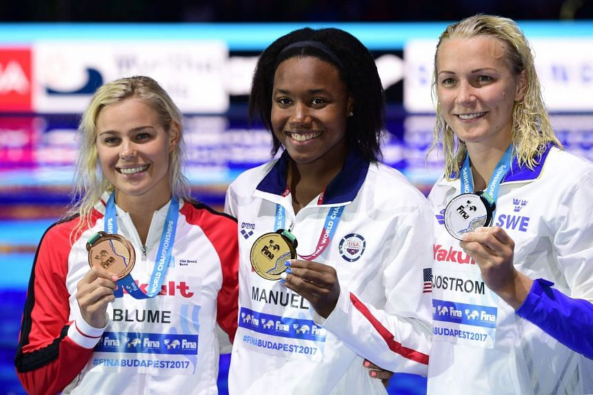 Sweden's Sarah Sjostrom, the US' Simone Manuel and Denmark's Pernille Blume celebrate with their medals.