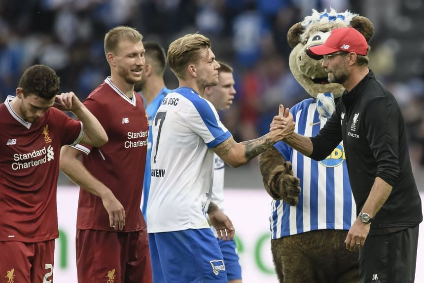 Klopp (right) shakes hand with Berlin's Alexander Esswein after the pre-season friendly.