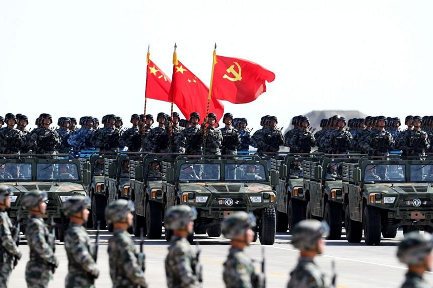 Soldiers of China's People's Liberation Army (PLA) march during a military parade to commemorate the 90th anniversary of the foundation of the army at the Zhurihe military training base, China on July 30, 2017.
