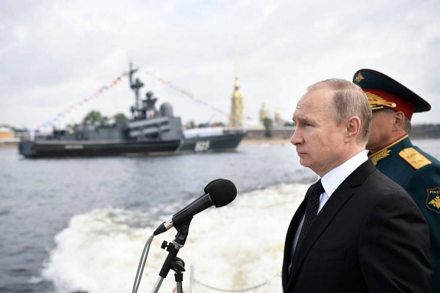 Russian President Vladimir Putin looking on during the Navy Day ceremony in St Petersburg on July 30, 2017.