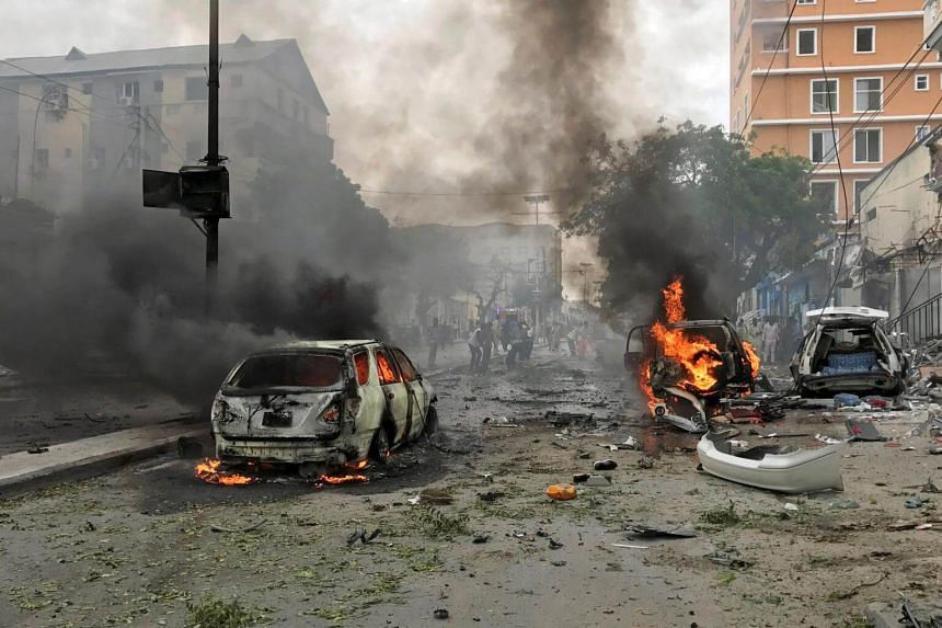 Vehicles burn at the scene of an explosion in Mogadishu, Somalia, on July 30, 2017.